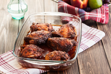 Roasted chicken drumsticks in casserole dish