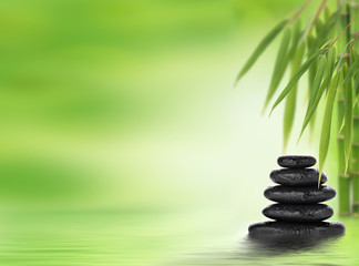 Spa background with stacked massage stones and bamboo