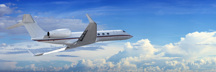 Wall Mural - Corporate jet cruising in a cloudy sky