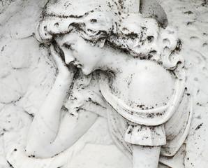 angelic image relief on gravestone