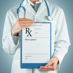 Doctor gives prescription paper