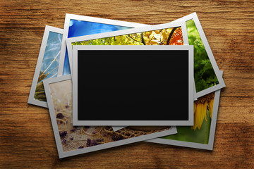 Pile of colorful photos with blank frame