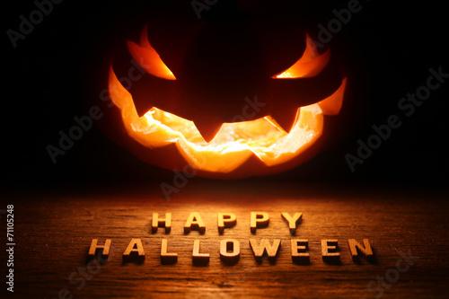 Spooky Halloween background with jack o lantern