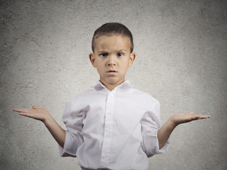 clueless child boy with arms out asking what's problem