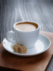 classic double espresso on wood table