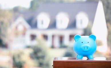 Real estate sale loan market concept. Piggy bank