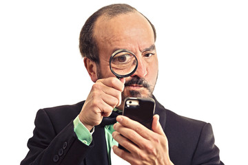man looking through magnifying glass on smartphone