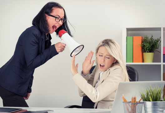 Man boss shouting at employee on megaphone
