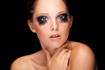 Beautiful girl with fashion crying make up and blue eyes