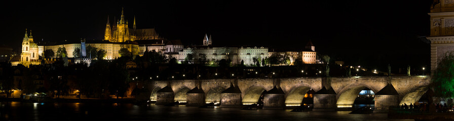 Prague Castle and Charles Bridge at night. Panorama.
