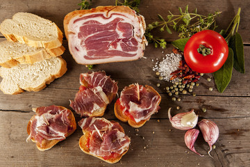 Spanish tapas presented on a wooden floor