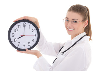 happy young female doctor with office clock isolated on white