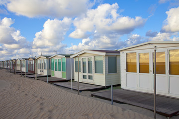 Several beachhouses in a row on beach in The Netherlands