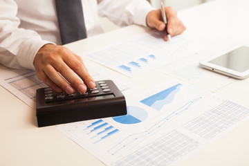 Accountant checking numbers on a business document