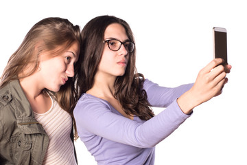 Two young girls making self-portrait with smart phone