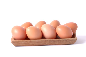 eggs in wooden square bowl isolated white background