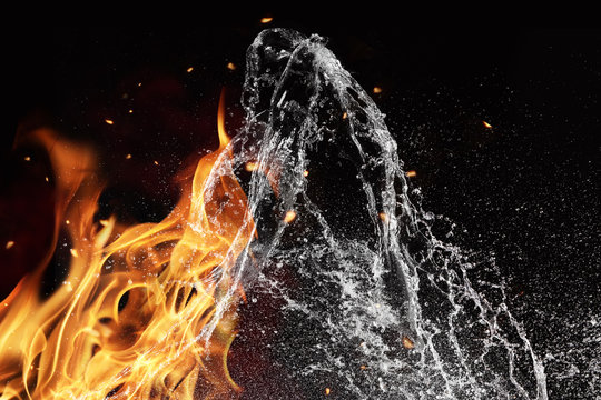 Fire and water elements on black background
