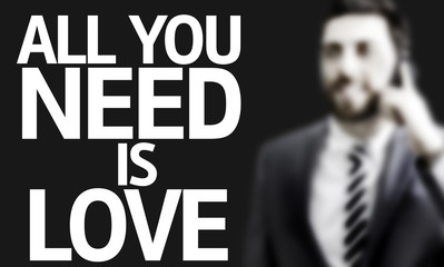 Business man with the text All you Need is Love