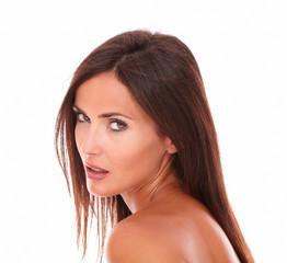 Serious hispanic woman looking at camera