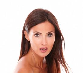 Surprised hispanic woman looking at camera