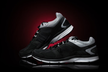 Sport shoes, running accessory. Isolates Black Background Red Sp