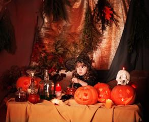happy little witch with pumpkin lantern