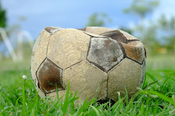 old deflated soccer ball, old deflated football on the groud