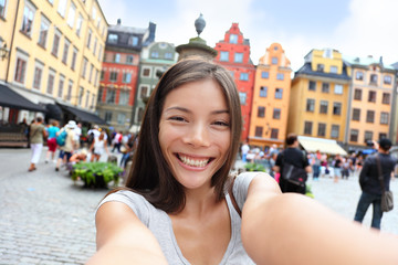 Asian woman taking self portrait selfie Stockholm