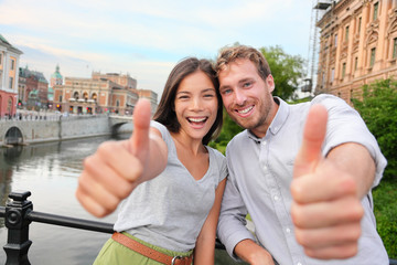 Thumbs up couple happy in Stockholm, Sweden