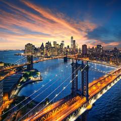 New York City - sunset over manhattan and brooklyn bridge