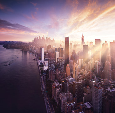 New York City - colorful sunset over manhattan with sunbeams