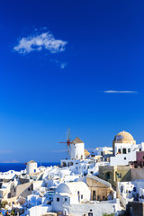 Wall Mural - Windmill at the village of Oia in Santorini, Greece