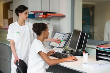 Female nurses working in office