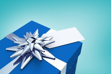 Composite image of blue and silver christmas gift