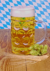 Bavarian beer, wheat, hop on wooden background