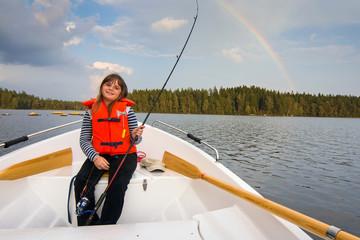 Cute fishing girl in beautiful scenery