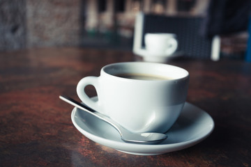 Cup of coffee on rustic table