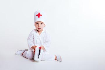 a little boy dressed as doctor