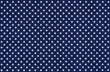 Dunkelblauer Stoff mit weißen Punkten