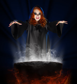 Witch with cauldron on blue rays background