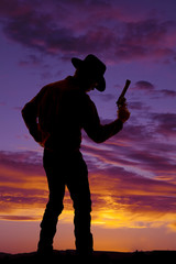Wall Mural - silhouette of a cowboy with a gun in his hand