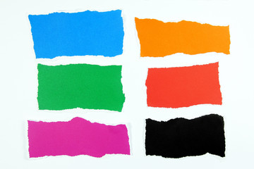 colorful torn paper layers on white background