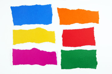 colorful torn paper on white background