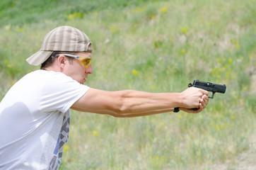 Man shoots a gun at the shooting range