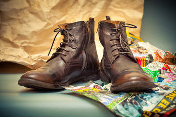 Expensive high leather boots. Autumn - spring shoes brown