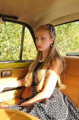 Pretty girl inside old car