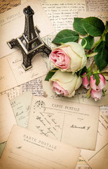 roses, antique french postcards and souvenir Eiffel Tower