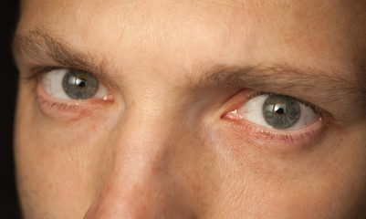 Close up photo of Caucasian man eyes