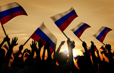 Silhouettes of People Holding Flag of Russia