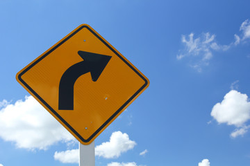 Curved Road Traffic Sign against blue sky